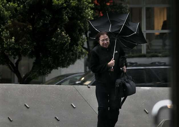 Deborah Spanier of Mill Valley struggles with her umbrella in the high winds and rain as she goes to work at the Federal Building, Thursday March 24, 2011, in San Francisco, Calif. Photo: Lacy Atkins, The Chronicle