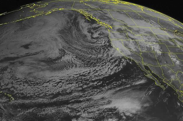 This NOAA satellite image taken Thursday, March 24, 2011 at 2:00 PM EDT shows clouds cover most of the Western U.S.  A low pressure system moves onshore and produces a cold front that stretches down the West Coast.  This brings periods of heavy rain showers with heavy snow in the Cascades and Sierra Nevadas. Photo: AP