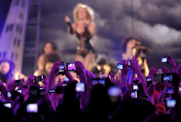 The crowd of six thousand snap pictures of popstar princess Britney Spears as she performs at the Bill Graham Civic Auditorium for the Good Morning America Spring Concert Series, Sunday March 27, 2011, in San Francisco, Calilf. Spears performed three songs to introduce her new album Femme Fatale which goes on sale Tuesday. Photo: Lacy Atkins, The Chronicle