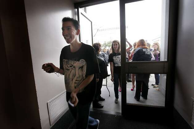 Fans of popstar princess Britney Spears rush through the doors as they open for the free concert  at the Bill Graham Civic Auditorium for the Good Morning America Spring Concert Series, Sunday March 27, 2011, in San Francisco, Calilf. The concert was supposed to be in the castro but because of the rainy weather was moved to the auditorium. Photo: Lacy Atkins, The Chronicle