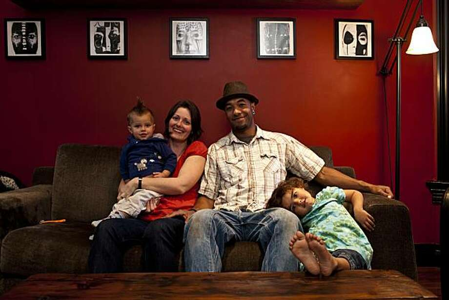 On the couch with Shannon and Maurice Cavness with their kids Kai, 1, and Maia, 3, in San Francisco, California on Mar. 3, 2011. Photo: Peter DaSilva, Special To The Chronicle
