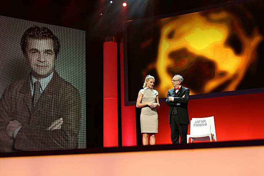 Berlinale Film Festival director Dieter Kosslick and German host Anke Engelke stand next to the empty seat of Iranian imprisoned director Jafar Panahi during the awards ceremony of the international Berlinale film festival on February 19, 2011 in Berlin.The 61st edition of the festival, which ran from February 10 to 20, showcased 22 films in its main programme including 16 in the running for the festival's coveted Glden and Silver Bear prizes. Photo: Valery Hache, AFP/Getty Images