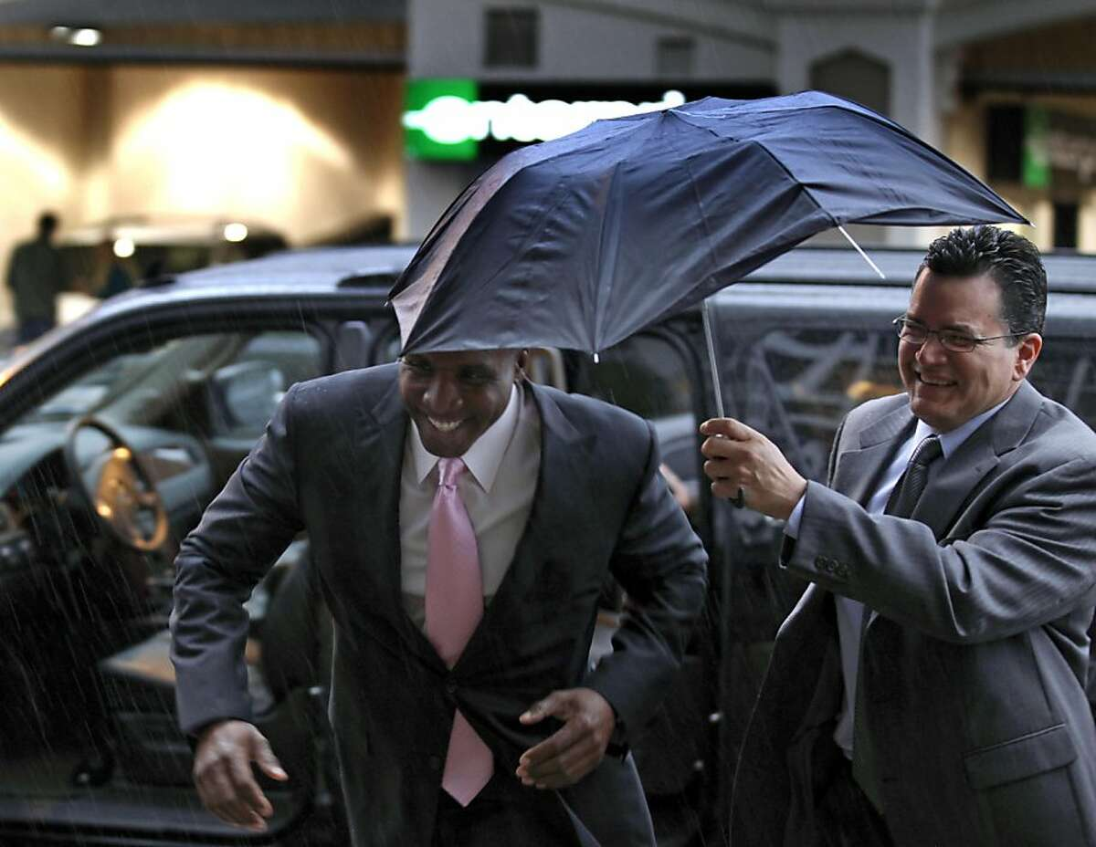 Former baseball home run king Barry Bonds, arrives for his criminal perjury trial at federal court in San Francisco, Thursday, March 24, 2011