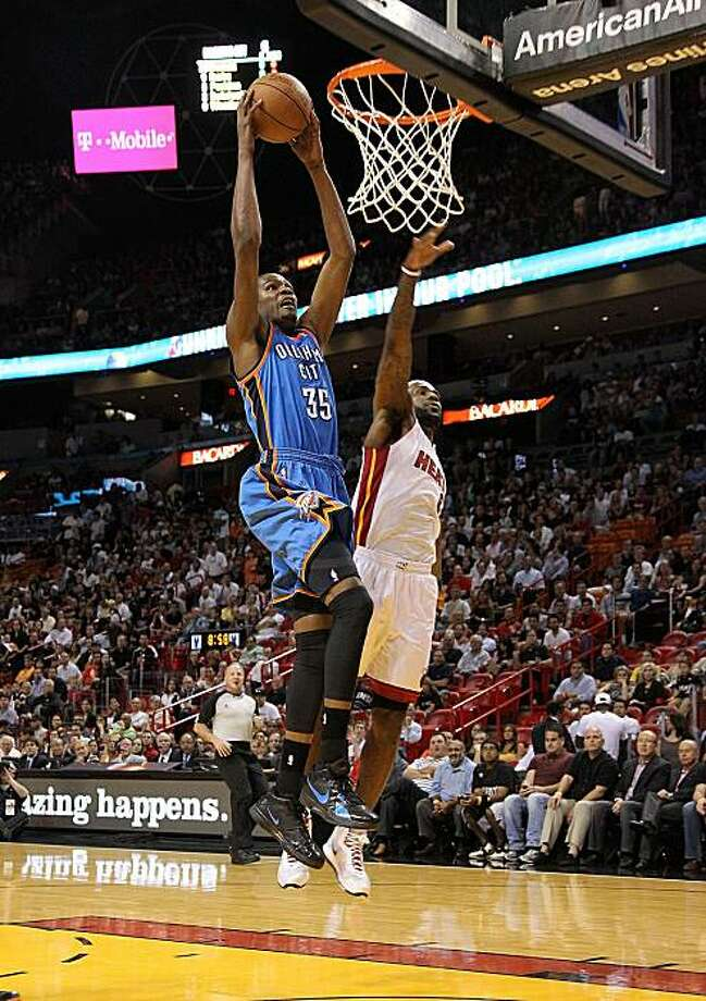 MIAMI, FL - MARCH 16: Kevin Durant #35  of the the Oklahoma City Thunder dunks over LeBron James #6 of the Miami Heat during a game at American Airlines Arena on March 16, 2011 in Miami, Florida. NOTE TO USER: User expressly acknowledges and agrees that,by downloading and/or using this Photograph, User is consenting to the terms and conditions of the Getty Images License Agreement. Photo: Mike Ehrmann, Getty Images
