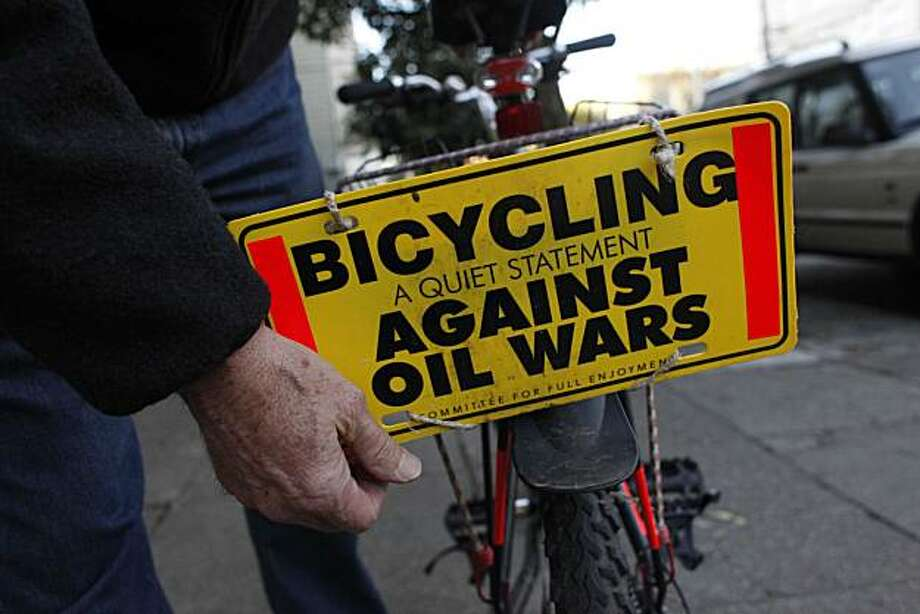 David Hartsough, 70, longtime peace activist who founded Nonviolent Peaceforce, adjusts a sign on the back of his bike on Friday January 14, 2011 in San Francisco, Calif. Photo: Mike Kepka, The Chronicle