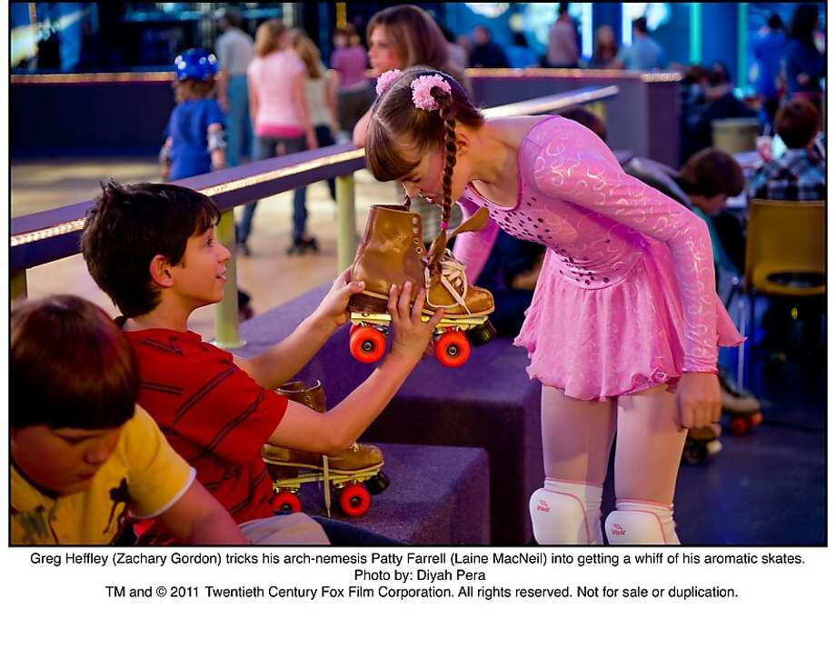"Greg Heffley (Zachary Gordon) tricks his arch-nemesis Patty Farrell (Laine MacNeil) into getting a whiff of his aromatic skates, ""Diary of a Wimpy Kid."" Photo: Diyah Pera, 20th Century Fox"