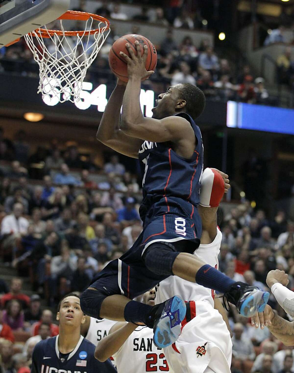 Connecticut's Kemba Walker (15) drives against San Diego State during the second half of a West regional semifinal in the NCAA college basketball tournament Thursday, March 24, 2011, in Anaheim, Calif.