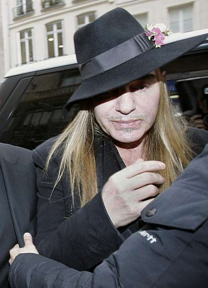 Fashion designer John Galliano arrives at a police station in Paris, Monday, Feb. 28, 2011. Galliano arrived Monday at a Paris police station to face accusations that he made illegal anti-Semitic slurs, hours after a video emerged of the famed fashion designer praising Adolf Hitler. The Gibraltar-born designer, wearing a wide-brimmed black hat, made no comment to reporters as he entered to face claims by a couple that he made an anti-Semitic remark during a dispute at a trendy Paris cafe. Photo: Michel Euler, AP