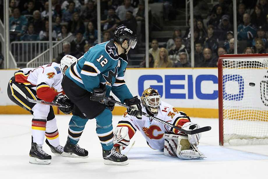 SAN JOSE, CA - MARCH 23:  Patrick Marleau #12 of the San Jose Sharks scores on Miikka Kiprusoff #34 of the Calgary Flames at the HP Pavilion on March 23, 2011 in San Jose, California. Photo: Ezra Shaw, Getty Images