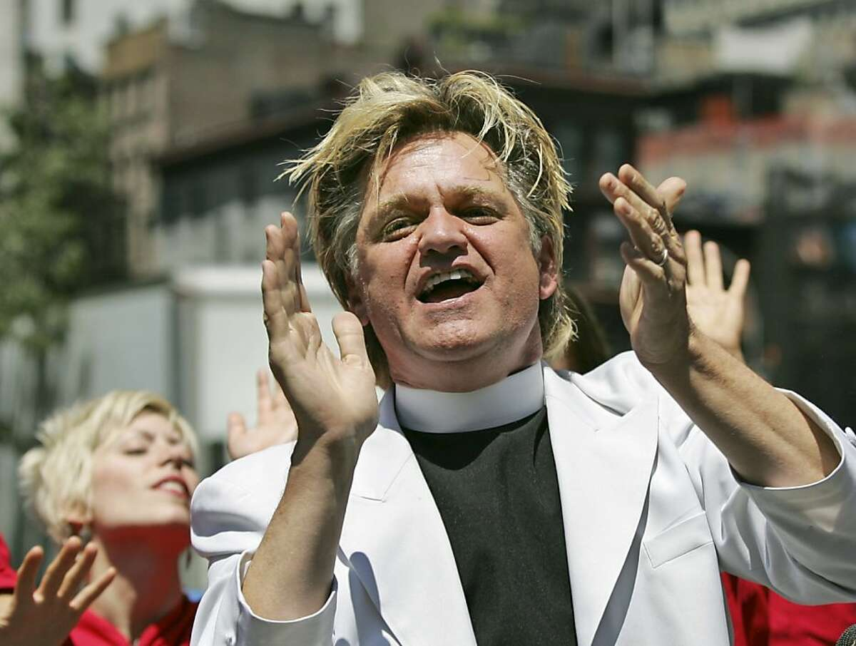 """Bill Talen, also known as """"Reverend Billy,"""" sings with the Stop Shopping Gospel Choir in Union Square in New York, Monday, July 2, 2007, to protest his arrest there Friday night while reciting the First Amendment. Police say Talen hassled officers by following them while shouting through a bullhorn. Officers repeatedly asked Talen to stop before arresting him on harassment and disorderly conduct charges, according to police. Talen is calling for the charges to be dropped."""