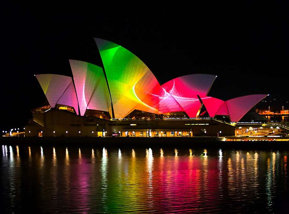 "----EDITORS NOTE---- RESTRICTED TO EDITORIAL USE   MANDATORY CREDIT ""AFP PHOTO / GOOGLE / Chris PHILLIPS""           NO MARKETING NO ADVERTISING CAMPAIGNS - DISTRIBUTED AS A SERVICE TO CLIENTS     NO ARCHIVES  This YouTube Symphony Orchestra 2011 handout photo taken on March 17, 2011 shows projections on the sails of the Sydney Opera House, as a preview test for the final YouTube Symphony Orchestra concerts. On March 20, the Sydney Opera House will be lit up during the final Symphony Orchestra concert of the multi-media performance which will be projected onto the Opera House sails and live streamed for a worldwide audience on YouTube. Photo: Chris Phillips, AFP/Getty Images"