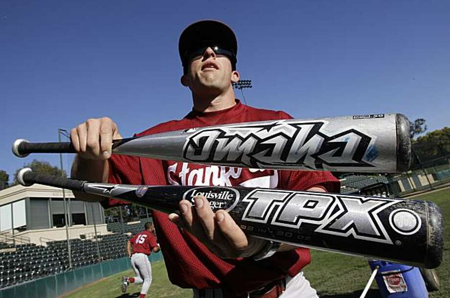 In this photo taken, Thursday, Feb. 3, 2011, Stanford baseball player Brock Ungricht holds up some new metal bats during the NCAA college baseball team's practice in Stanford, Calif. Many college players have been swinging the new and safer metal bats since fall workouts, getting a feel for the shrunken sweet spot. Coaches and players figure power numbers and averages will be worse and ERAs improved in the initial season as everybody adjusts. (AP Photo/Paul Sakuma) Photo: Paul Sakuma, AP