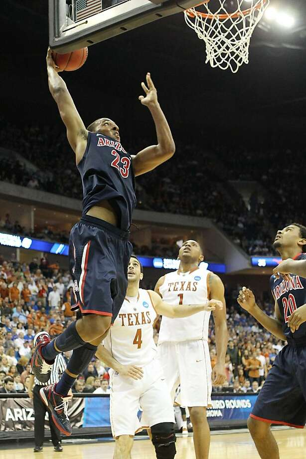 TULSA, OK - MARCH 20:  Derrick Williams #23 of the Arizona Wildcats goes up to dunk the ball against the Texas Longhorns during the third round of the 2011 NCAA men's basketball tournament at BOK Center on March 20, 2011 in Tulsa, Oklahoma. Photo: Ronald Martinez, Getty Images