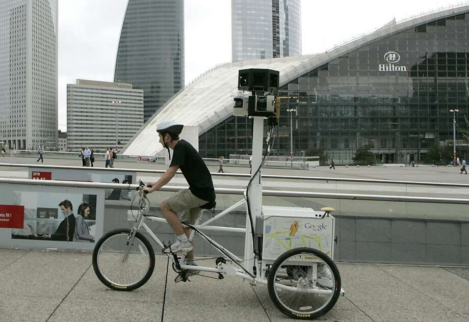 """In this Aug. 7, 2009 file photo Google employee Arthur Poirier, on a camera-equipped tricycle, records images for Google's Street View Maps in Paris, Friday, Aug. 7, 2009. Google Inc. issued an apology Friday May 14, 2010, acknowledging it has been vacuuming up and recording fragments of people's online activities broadcast over public Wi-Fi networks in many countries while expanding its street mapping feature. The German minister for consumer protection Ilse Aigner criticized Google on Saturday, May 15, saying the U.S. Internet giant still lacks an understanding of the need for privacy, calling it an """"alarming incident"""" happening apparently illegally over some years. Photo: Jacques Brinon, AP"""
