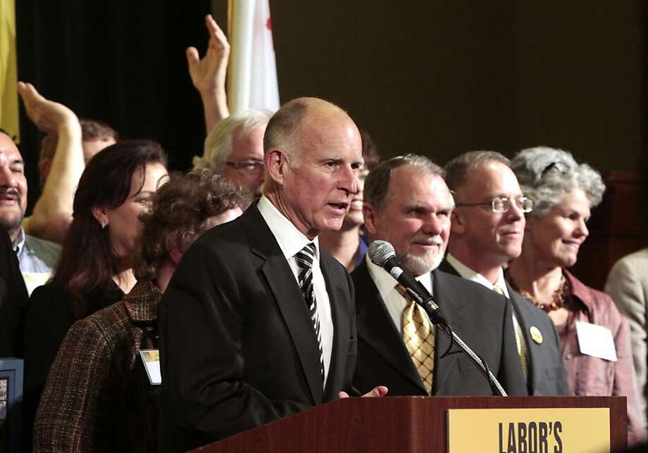 Gov. Jerry Brown is welcomed by union members as he addresses Labor's 2011 Joint Legislative Conference in Sacramento,  Calif., Monday March 21, 2011.   While talking about the on going negotiations on his state budget plan,  Brown criticized Republican lawmakers as being obstructionists. Photo: Rich Pedroncelli, AP