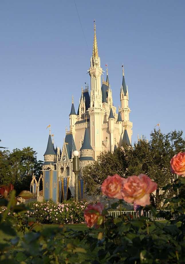 Colorful flowerbeds surround Cinderella Castle in the Magic Kingdom at Walt Disney World Resort. Photo: Courtesy, Disney World Resort
