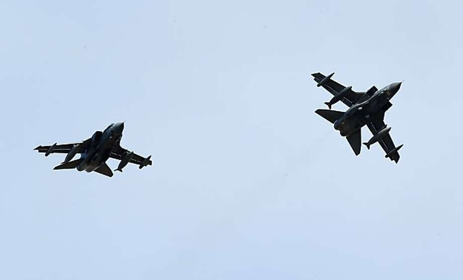 LOSSIEMOUTH, UNITED KINGDOM - MARCH 18:  RAF Tornados fly above the Lossiemouth air base on March 18, 2011 in Lossiemouth, Scotland. UK defence forces will help to enforce a no-fly zone over Libya after the UN voted in favour of a resolution that backed 'all necessary measures', except a foreign occupation force, to protect Libyan civilians.. Photo: Jeff J Mitchell, Getty Images
