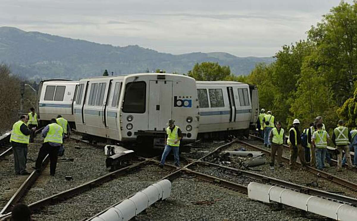 """BART crews work the scene following a morning derailment of a 10-car San Francisco bound train on Sunday, March 13, 2011, at the Concord BART station in Concord, Calif. BART spokesman Linton Johnson says two cars on a train heading to San Francisco cameoff the tracks as it pulled out of the station around 9:26 a.m. Sunday. Contra Costa County Fire Battalion Chief William Ericson says three people were transported to a hospital with what he termed """"minor injuries."""" The cause of the derailment is underinvestigation."""