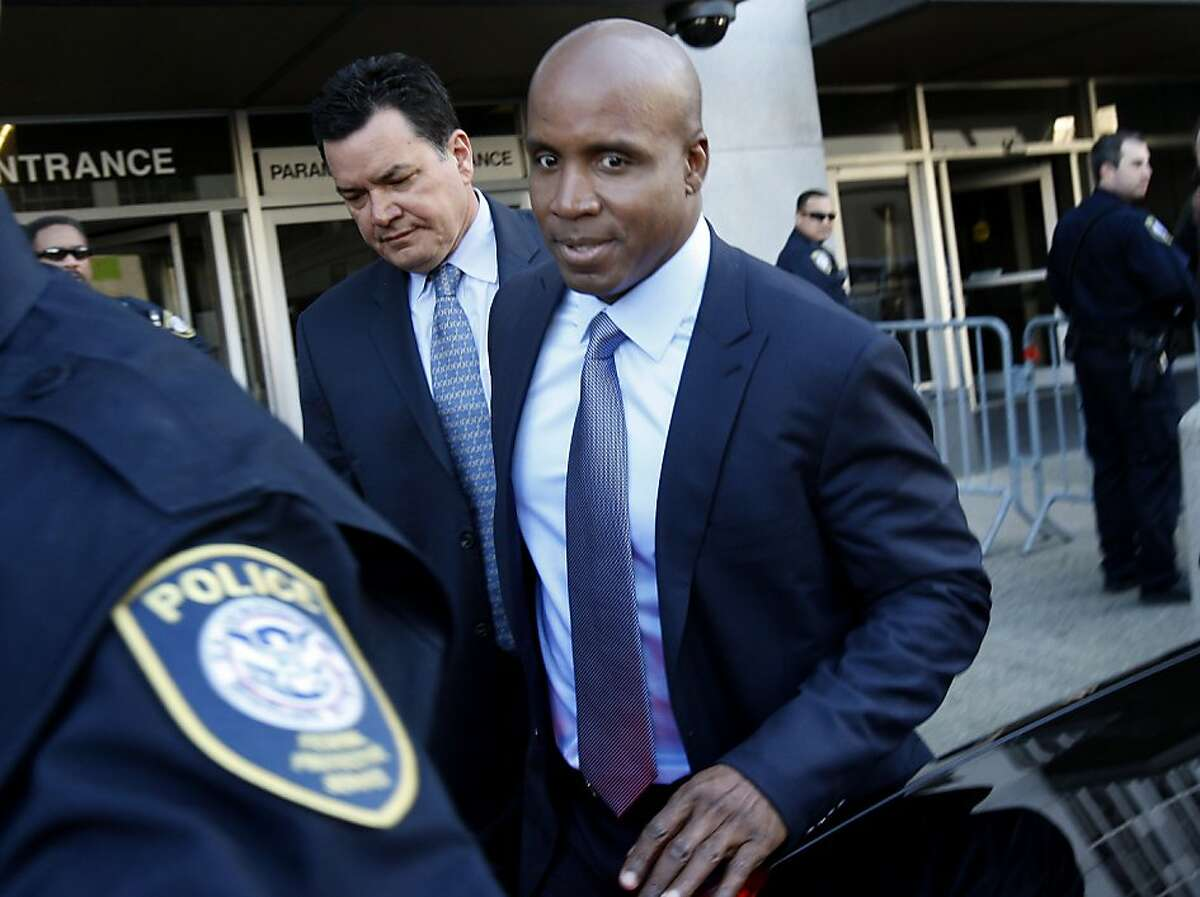 Barry Bonds leaves the Federal Building in San Francisco after being arraigned Tuesday.