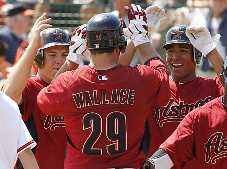 Houston Astros' Brett Wallace (29) celebrates with Angel Sanchez, right, and J.B. Shuck, left, after hitting a grand slam off Baltimore Orioles pitcher Kevin Gregg in the fifth inning of a spring training baseball game against the Baltimore Orioles in Sarasota, Fla., Tuesday, March 15, 2011. Photo: AP