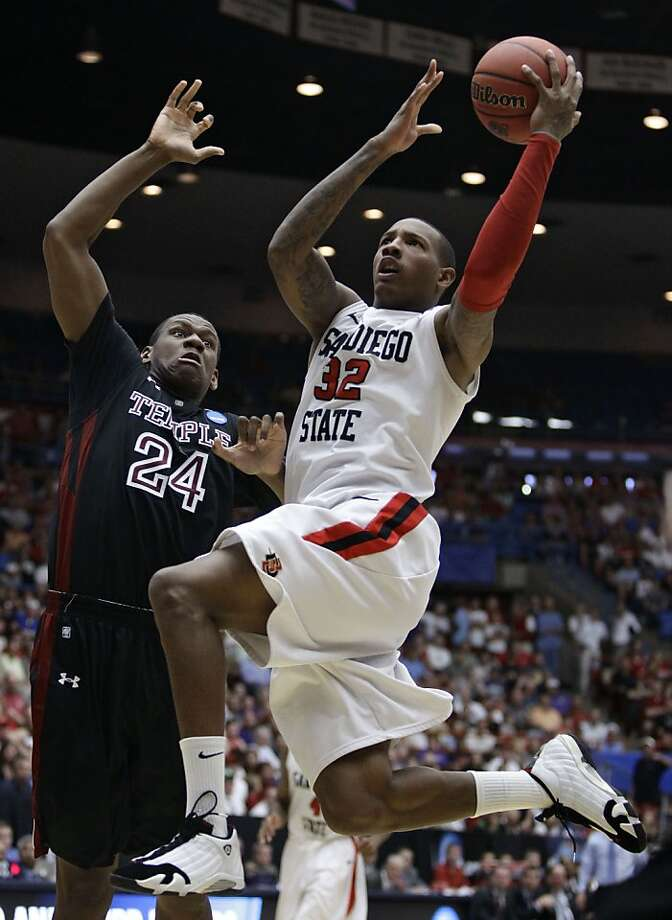 San Diego State's Billy White (32) drives to the basket against Temple's Lavoy Allen (24) during a West Regional NCAA college basketball tournament third round game Saturday, March 19, 2011, in Tucson, Ariz. Photo: Matt York, AP