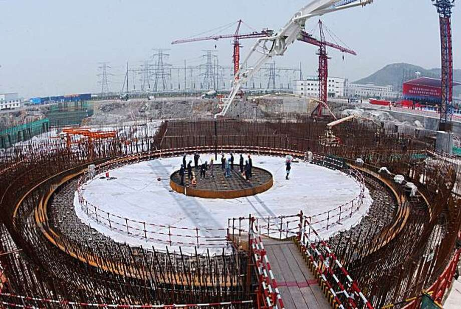 **ADVANCE FOR SUNDAY, JAN. 13--FILE** This  photo released by China's official Xinhua news agency, an April 28, 2006, file photo, shows the construction site of Qinshan Phase II Nuclear Power Station located in Haiyan County, east China's Zhejiang province. Global warming and rocketing oil prices are making nuclear power fashionable, drawing a once demonized industry out of the shadows of the Chernobyl disaster as a potential shining knight of clean energy. (AP Photo/Xinhua, Tan Jin, File) Photo: Tan Jin, AP