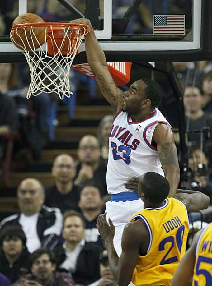 Sacramento Kings guard Marcus Thornton (23) breaks away for a dunk against Golden State Warriors defender Ekpe Udoh during the first half of an NBA basketball game in Sacramento, Calif., Monday, March, 14, 2011. Photo: Steve Yeater, AP