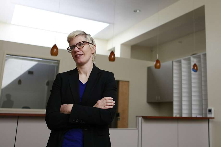 Carolina Hansen, executive director of Women's Community Clinic, gets their brand new recently re-located office ready to open on Friday March 11, 2011 in San Francisco Calif. Photo: Jill Schneider, Special To The Chronicle