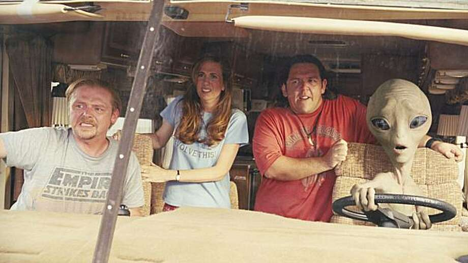 "(L to R) Graeme (SIMON PEGG), Ruth (KRISTEN WIIG), Clive (NICK FROST) and Paul (SETH ROGEN) try to stay on the highway in the comedy-adventure ""Paul"". While in America's UFO heartland, two sci-fi fans meet an alien who brings them on an insane road trip that will rock their universe forever. Photo: Double Negative, Universal Pictures"