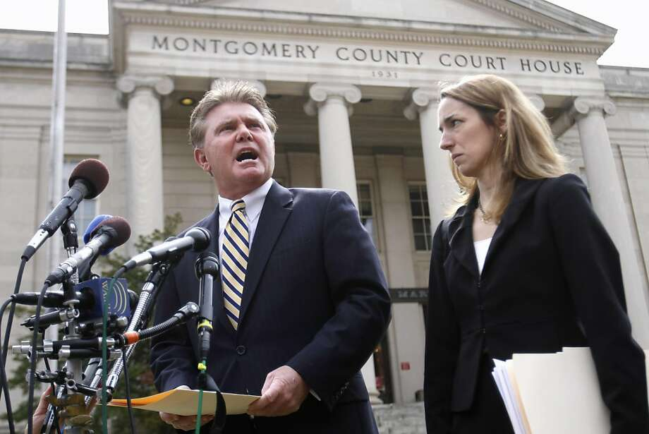 Montgomery County, Md., State's Attorney John McCarthy, left, accompanied by Assistant State's Attorney Marybeth Ayres, speaks to reporters outside Montgomery County District Court, in Rockville, Md. Monday, March 21, 2011, after  a bond hearing for Brittany Norwood, who is charged with killing a co-worker at a Bethesda, Md. yoga clothing shop. Photo: Jacquelyn Martin, AP
