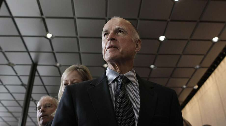 Gov. Jerry Brown arrives at a news conference at Bank of America Tower in San Francisco, Friday, March 4, 2011. Photo: Jeff Chiu, AP
