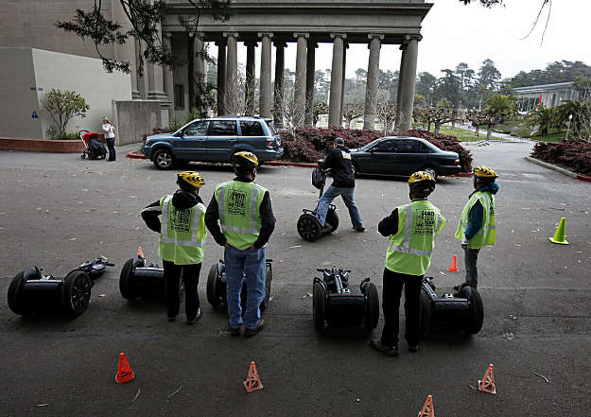 A Segway tour group watches an instructor show the proper way to turn on a Segway Sunday March 13, 2011. Segway tours in Golden Gate Park in San Francisco, Calif. are a new popular way to see the sights, but a small group of people don't like the latest commercialization of their park.