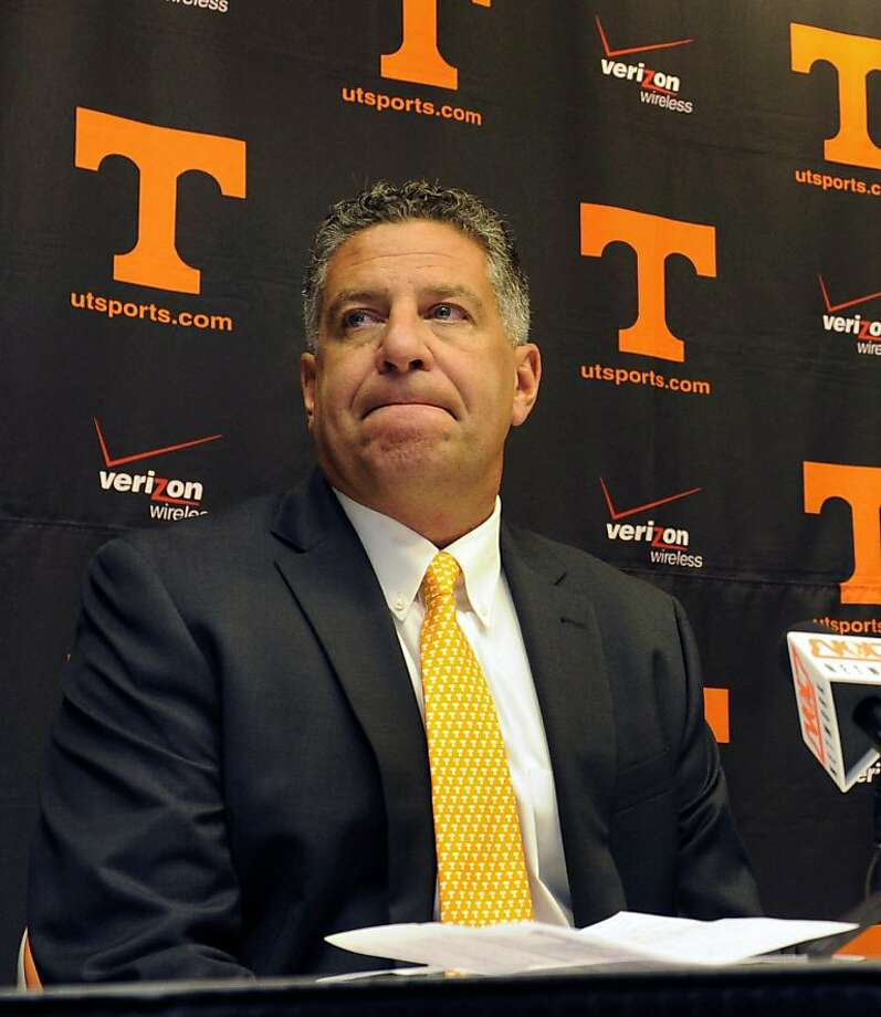 FILE - This Sept. 10, 2010, file photo shows University of Tennessee men's basketball coach Bruce Pearl grimacing during a news conference, where  Pearl expressed remorse for giving misleading information to the NCAA during an investigation into the school's basketball program, in Knoxville, Tenn.  A person with knowledge of the decision says says Tennessee has fired Pearl after a season that saw the coach charged with unethical conduct for lying to NCAA investigators during a probe into recruiting. The person spoke on condition of anonymity because the university has not announced the firing. Photo: Michael Patrick, AP