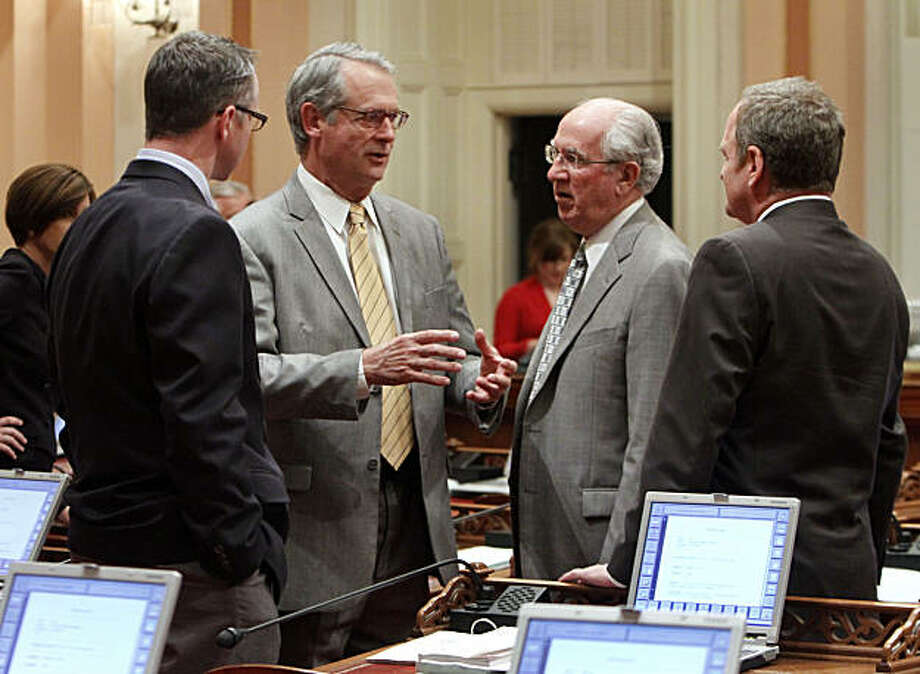 "Republican state Senators from left, Anthony Canella, of Ceres,  Bill Emerson, of Redlands,  Tom Harman, of Huntington Beach, and Sam Blakeslee, of San Luis Obispo, talk at the Capitol in Sacramento,  Calif., Wednesday March 16, 2011.  The four GOP lawmakers are part of a group known as the ""Gang of 5"" who have been meeting with Democrats to try to work out a budget deal.   Both houses of the legislature are expected to vote of Gov. Jerry Brown's budget proposal. Photo: Associated Press, AP"