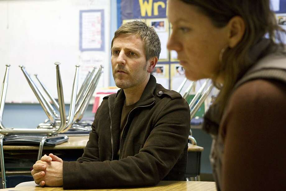 El Dorado Elementary School Principal Tai Schoeman participates in a parent-teacher conference with 3rd grade teacher Lindsay Hatfield (right) at the school in San Francisco, Calif., on Friday, February 25, 2011. Schoeman is dealing with concerns that his school will see layoffs as teachers across the state will receive pink slips by March 15. Photo: Laura Morton, Special To The Chronicle