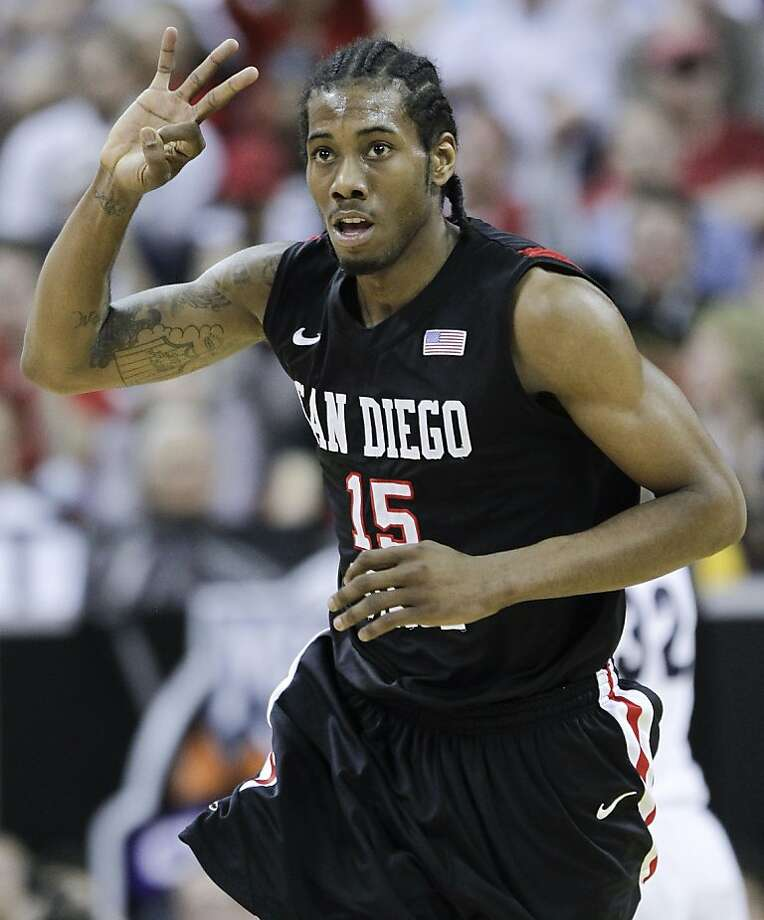 San Diego State's Kawhi Leonard gestures after hitting a three-point basket during the first half of an NCAA college basketball championship game against BYU in the Mountain West Conference tournament, Saturday, March 12, 2011, in Las Vegas. San Diego State won 72-54. Photo: Julie Jacobson, AP