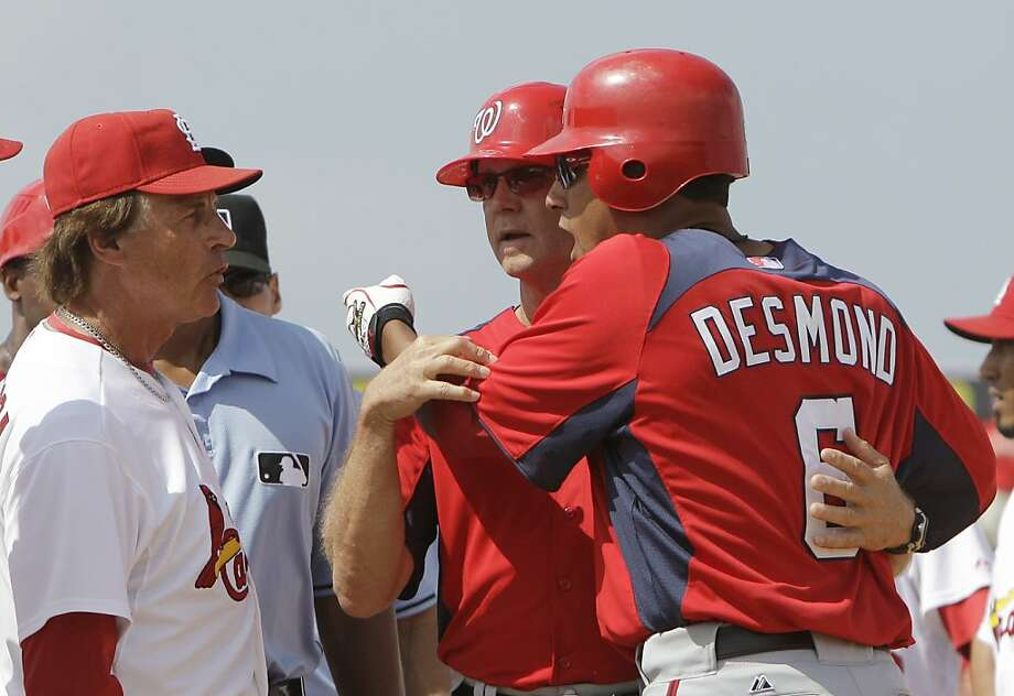 Washington Nationals' Ian Desmond (6) is held back from St. Louis Cardinals manager Tony La Russa during the seventh inning of a spring training baseball game, Monday, March 21, 2011 in Jupiter, Fla. Desmond was hit on a pitch by Cardinals pitcher MiguelBatista. Photo: Carlos Osorio, AP