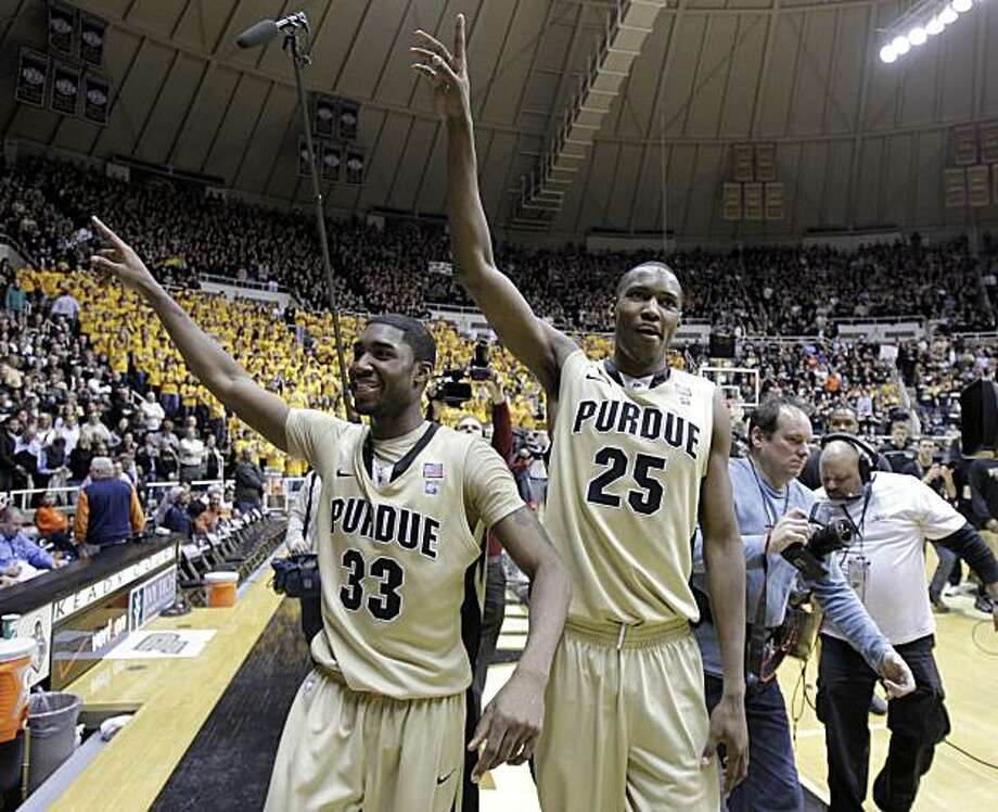 Purdue guard E'Twaun Moore, left, and center JaJuan Johnson wave to the fans as they leave the court following Purdue's 75-67 win over Illinois in the seniors' final home NCAA college basketball game, in West Lafayette, Ind., Tuesday, March 1, 2011. Photo: Michael Conroy, AP