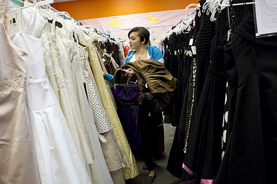 Jeanessa Bankhead, age 17, picks out prom dresses to try on at The Princess Project in San Francisco, Calif., on Sunday, March 13, 2011.  The Princess Project provides free prom dresses and accessories to high school girls who might otherwise not be able to afford them.  Each girl was allowed to take home one prom dress and one accessory for free. Photo: Laura Morton, Special To The Chronicle
