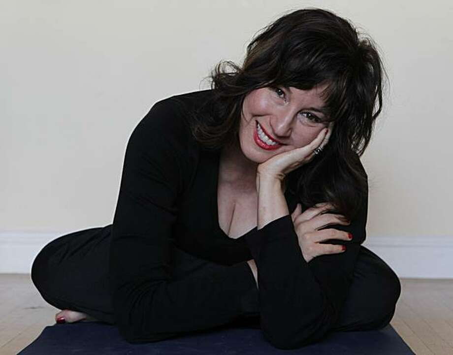 Author Dayna Macy relaxes after practicing yoga at her home in Berkeley, Calif., on Saturday, Feb. 5, 2011. Macy just wrote her first book titled, Ravenous, detailing how she turned to yoga as a way to control her appetite. Photo: Paul Chinn, The Chronicle