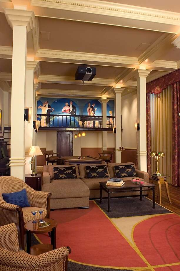 The lower level speakeasy, which was updated in 2005, features a bar area, a coffered ceiling with decorative columns, and a sitting area with a fireplace. Photo: Jennifer Salyers, TRI Coldwell Banker