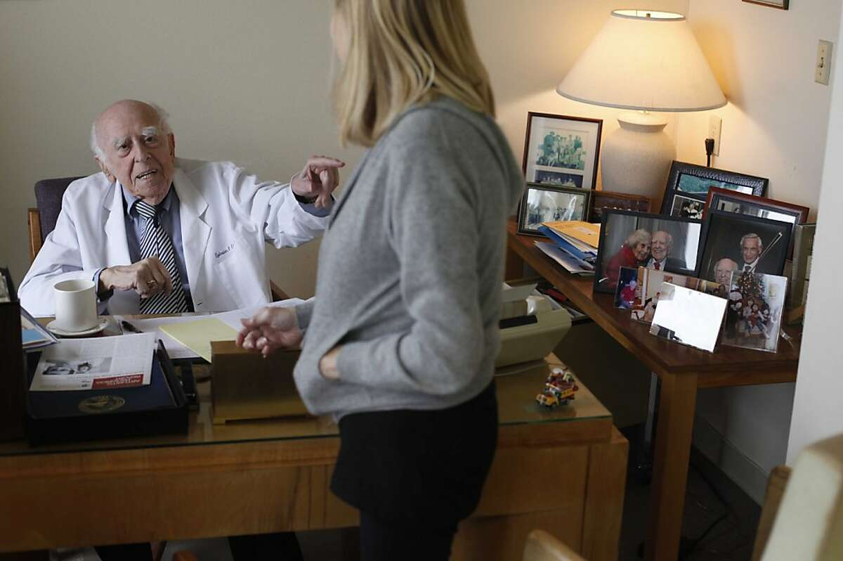 Dr. Ephraim Engleman, who turns 100 on March 24 and still practices medicine, meets with a patient in his office at UCSF on Wednesday March 3, 2011 in San Francisco, Calif.