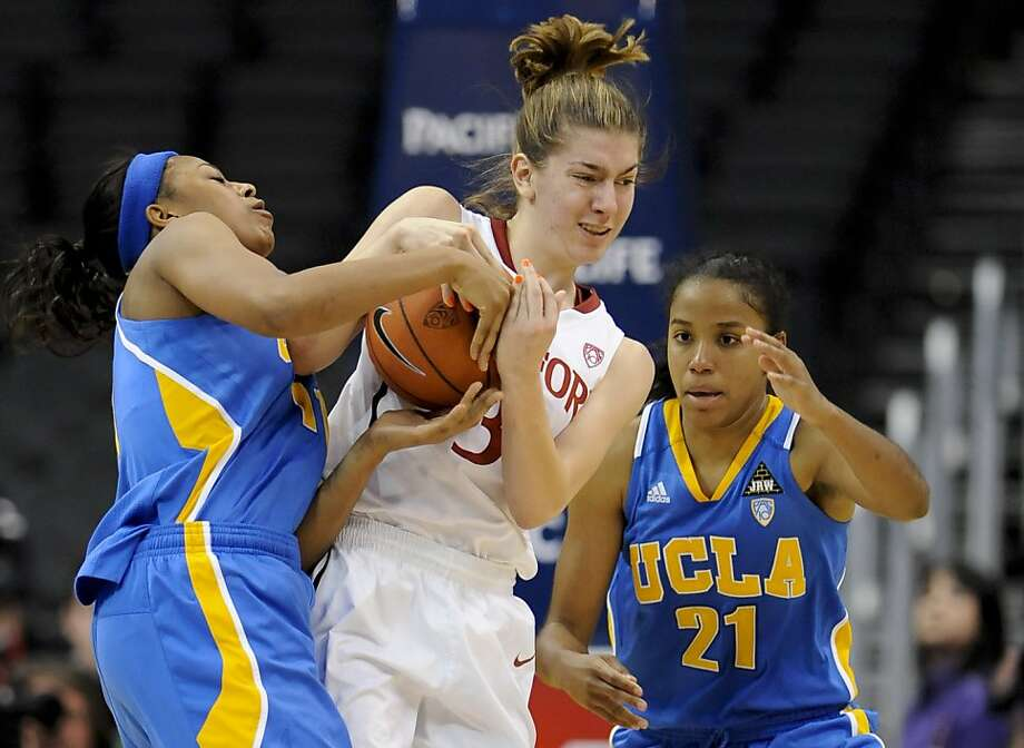 UCLA guard/forward Atonye Nyingifa, left and guard Doreena Campbell (21) double team Stanford guard Toni Kokenis (31) during the first half of an NCAA college basketball game at the Pac-10 conference chapionship, Saturday, March 12, 2011, in Los Angeles. Photo: Gus Ruelas, AP