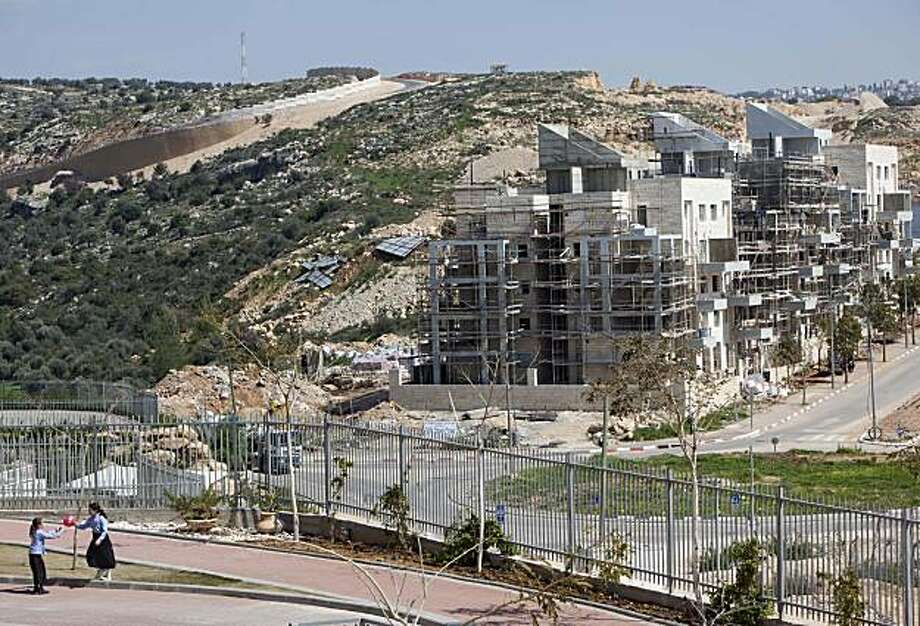 "A general view of a construction site in the West Bank Jewish settlement of Modiin Illit, Monday, March 14, 2011. The U.S. Embassy said Monday it was ""deeply concerned"" by Israel's plans to build hundreds of new homes in the West Bank following the deadlyattack that killed five family members, calling Israeli settlements ""illegitimate"" and an obstacle to peacemaking. Photo: Oded Balilty, AP"