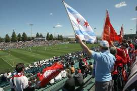 Soccer fans cheer their team on during a soccer match between the San Jose Earthquakes and Chicago Fire which ended up in a tie at Buck Shaw Stadium in Santa Clara on April 11, 2009.