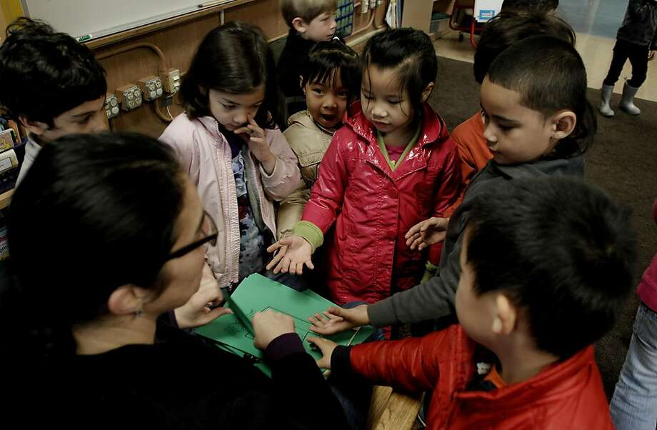Kindergarten teacher, Ruth Rousso, passes out assingments to kids during class at Claredon Elementary School on Friday March 18, 2011, in San Francisco, Ca.  School assignments numbers are released tomorrow and Clarendon is by far the the most requested school in the district for it's kindergarten classes, having 1200 requests for just 88 open spots. Photo: Michael Macor, The Chronicle