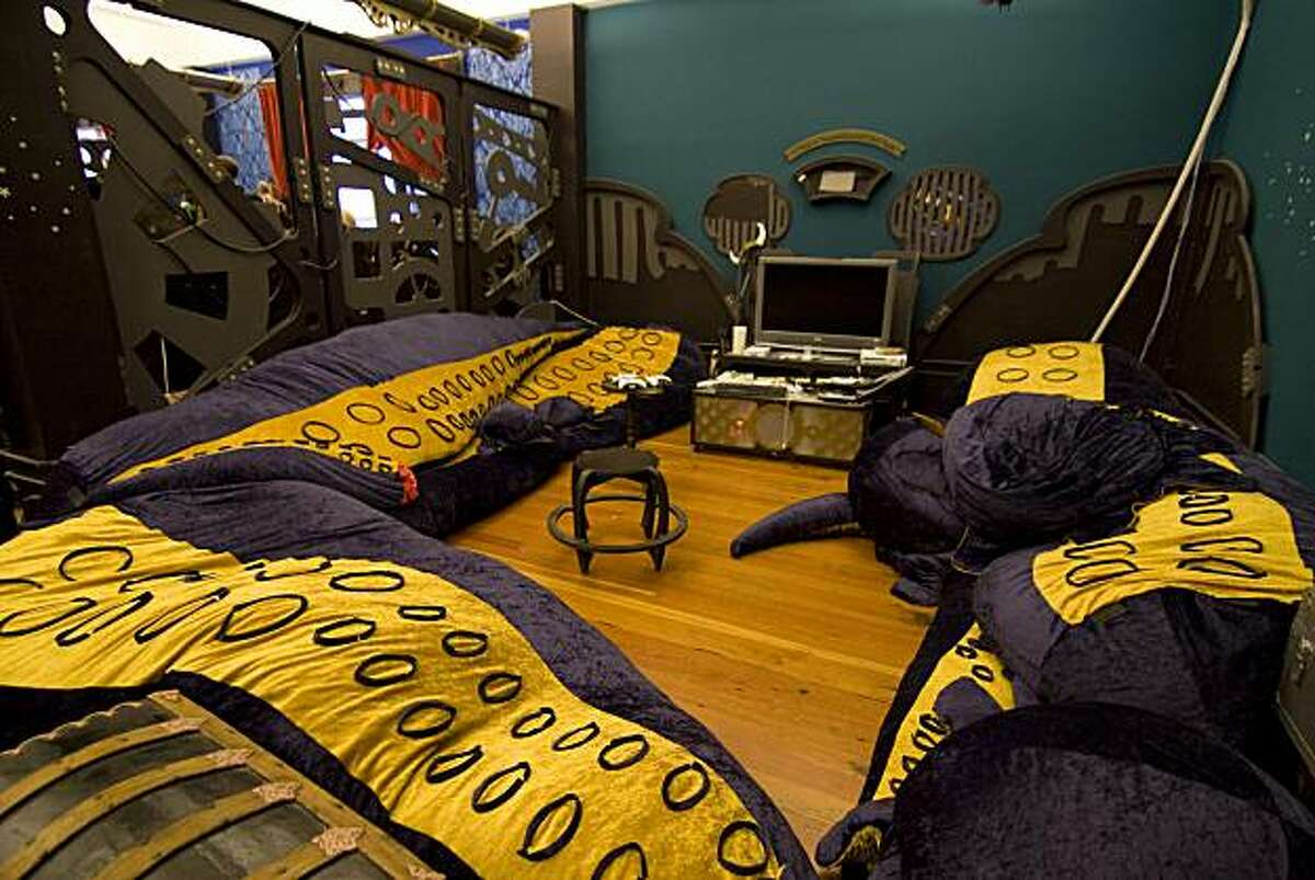 A game room with tentacle cushions at the online game company Three Rings. The office was designed by Oakland studio Because We Can.