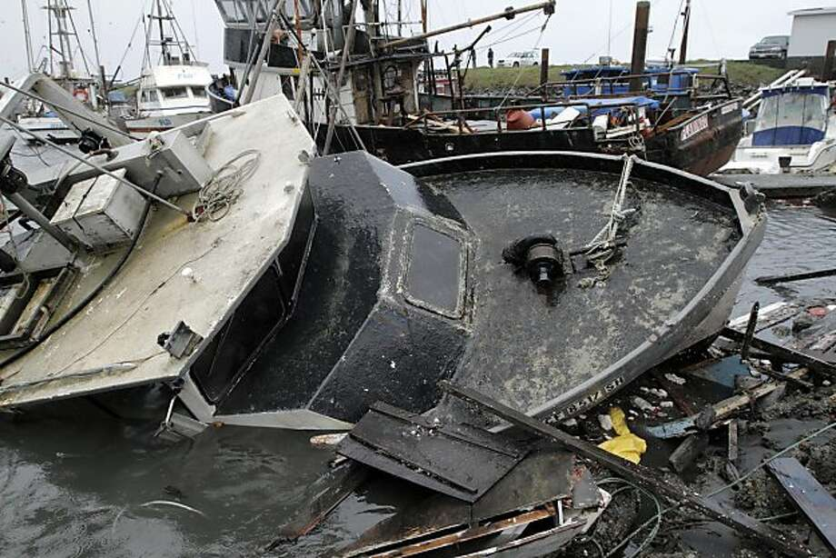 Half-sunken boats, docks and debris lie tangled Saturday, March 12, 2011, in Crescent City, Calif., after Friday's tsunami in Northern California. Photo: Josh Jackson, AP