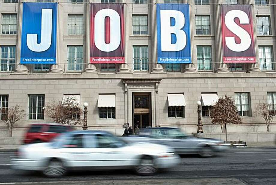 "(FILES) This February 22, 2011 file photo shows a banner reading ""Jobs"" hangs on thre facade of the US Chamber of Commerce in Washington,DC. The US unemployment rate fell to 8.9 percent in February from 9.0 percent the prior month as the economy added 192,000 jobs, triple the number in January, official data showed on March 4, 2011. The jobless rate unexpectedly fell for the third consecutive month and non-farm payrolls increased more than expected, while January job numbers were revised upward in a LaborDepartment report that raised hopes for recovery in the troubled labor market. Photo: Nicholas Kamm, AFP/Getty Images"