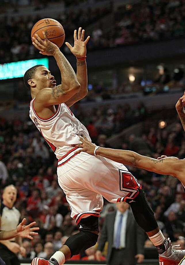 CHICAGO, IL - MARCH 12: Derrick Rose #1 of the Chicago Bulls puts up a shot against the Utah Jazz at the United Center on March 12, 2011 in Chicago, Illinois. The Bulls defeated the Jazz 118-100. NOTE TO USER: User expressly acknowledges and agrees that,by downloading and/or using this photograph, User is consenting to the terms and conditions of the Getty Images License Agreement. Photo: Jonathan Daniel, Getty Images